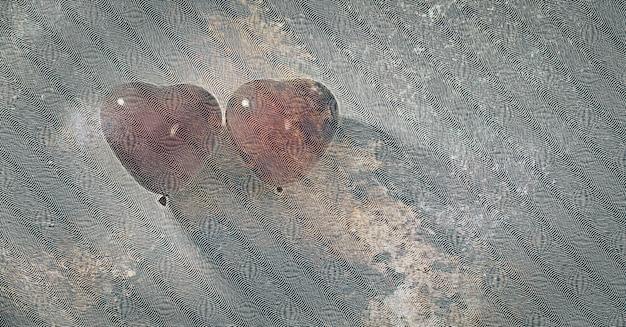 Coppia palloncini cuore rosso di filtro vintage