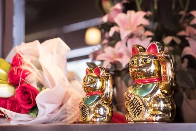Coppia di gatto fortunato dorato giapponese