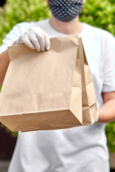 Courierin white hold go box food, delivery service, takeaway restaurants food delivery to home door.