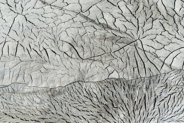 Texture di sfondo del suolo vulcanico incrinato