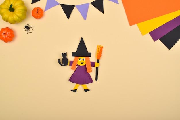 Artigianato per bambini fatto di carta. una strega fatta in casa. fallo da solo.