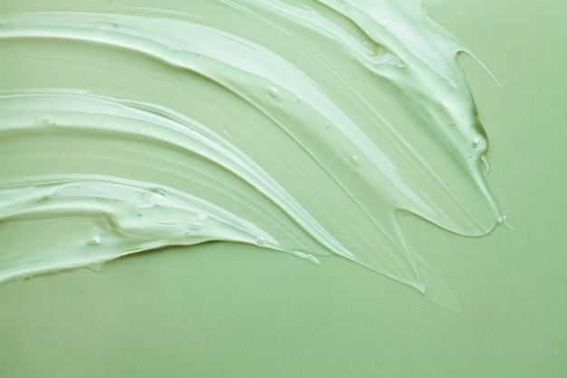 Gel crema verde campione cosmetico trasparente texture di sfondo sfumino