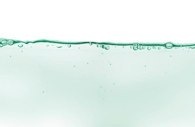 Gel crema trasparente siero cosmetico campione di olio texture con sfondo di bolle