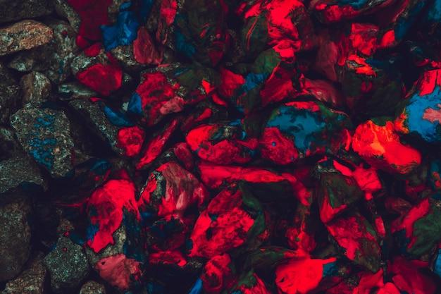 Sfondo creativo astratto piccoli ciottoli con vernice colorata