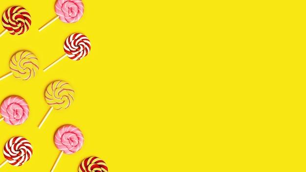Cornice creativa con con dolci lecca-lecca caramelle rotonde con strisce sul bastone su giallo