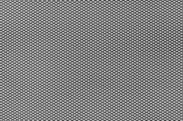 Griglia a rete con foro creativo su sfondo grigio