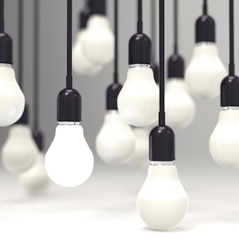 Lampadina di concetto creativo di direzione e di idea su gray