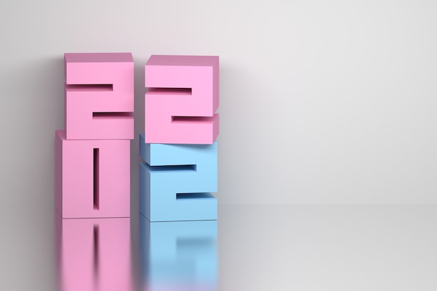 Nuovo anno creativo con grandi numeri dell'anno a forma di cubi rosa blu