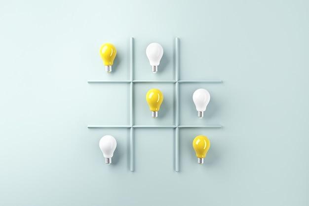 Idee di concetti di creatività con lampadina sul gioco del bue su sfondo di menta chiaro