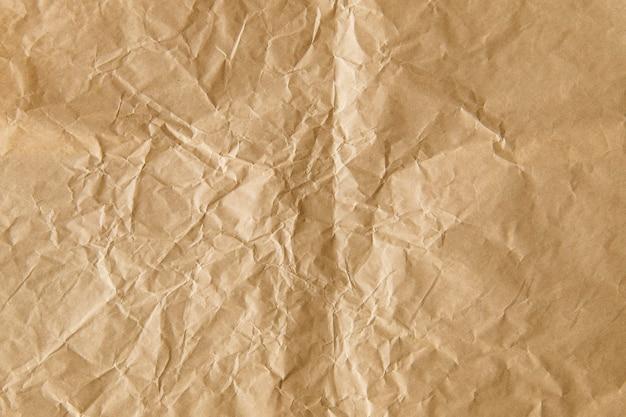 Fondo strutturato di carta marrone stropicciata