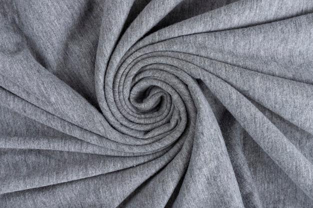 Trama di panno di lino sgualcito. tessuto stropicciato. grigio.