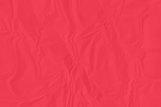 Fine di carta rossa sgualcita del fondo su
