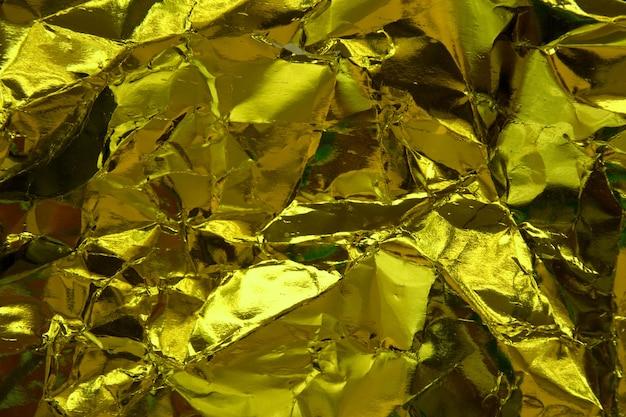 Trama di carta stropicciata in oro giallo.