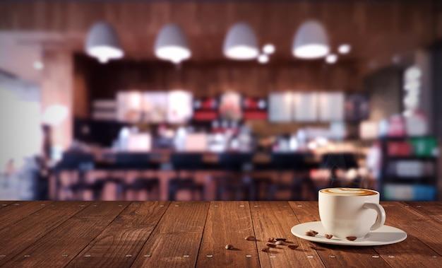 Una tazza di caffè latte caldo sul tavolo nella caffetteria con profondità di campo ridotta