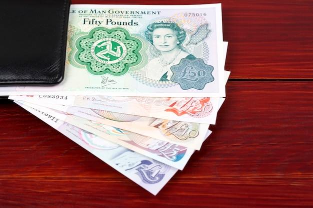 Valuta dell'isola di man nel portafoglio nero