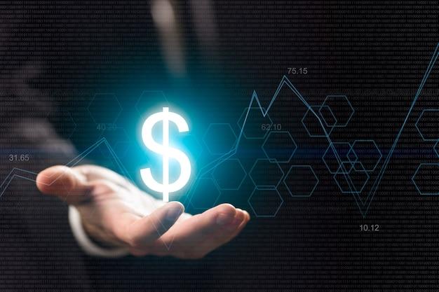Simboli di valuta sulla mano umana. fare soldi e ricchezza