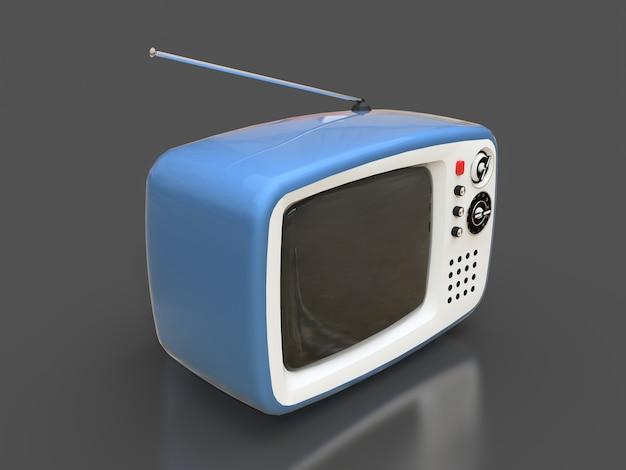 Carino vecchia tv blu con antenna su una superficie grigia