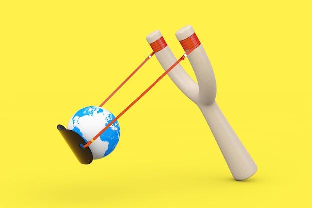 Pericolo fionda in legno arma giocattolo con globo terrestre su uno sfondo giallo. rendering 3d