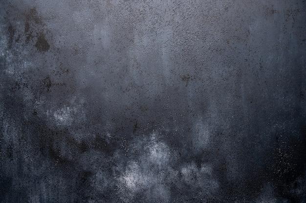 Sfondo scuro in legno con imitazione di macchie di gesso chiaro. orientamento orizzontale
