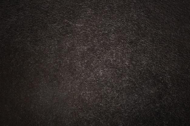 Sfondo scuro con angolo di evidenziazione astratta e texture di sfondo grunge vintage