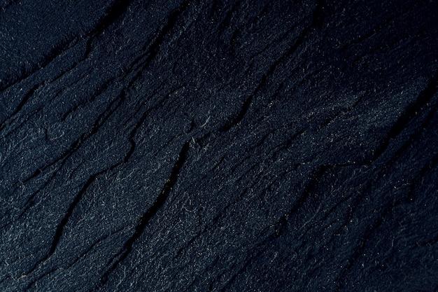 Ardesia di pietra di sfondo blu scuro