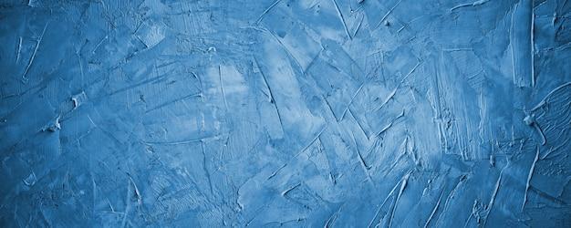 Cemento blu scuro o fondo della parete di struttura concreta blu scuro