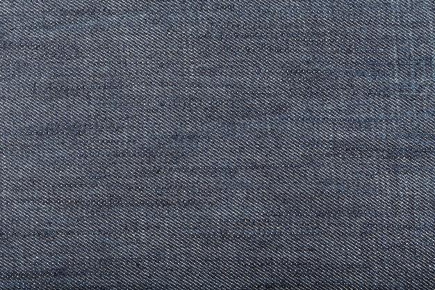 Sfondo di tessuto denim blu scuro. avvicinamento