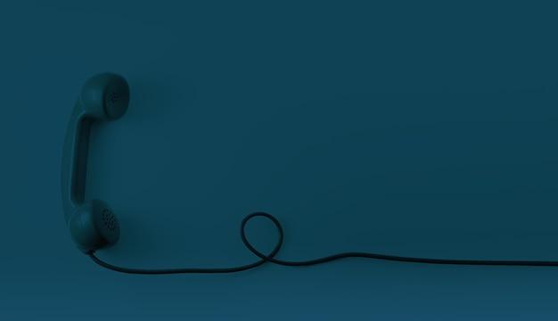 Una cornetta telefonica vintage blu scuro con sfondo blu scuro