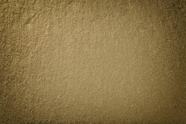 Fondo bronzo scuro di ardesia naturale. struttura del primo piano di pietra marrone. macro di sfondo grafite