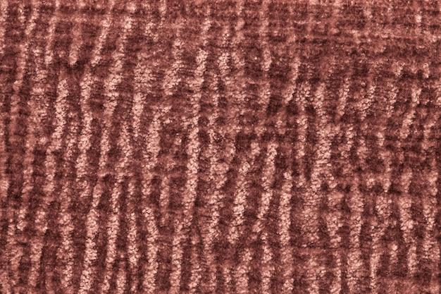 Sfondo soffice marrone scuro di panno morbido e soffice. struttura del tessuto simile a pelliccia della peluche, primo piano.