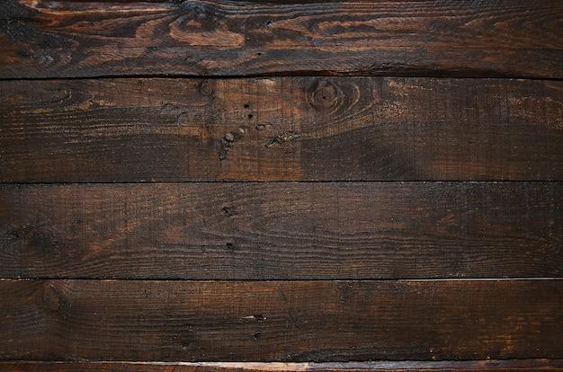 Fondo di legno delle plance del granaio invecchiato rustico marrone scuro. spazio per testo, copia, lettere.