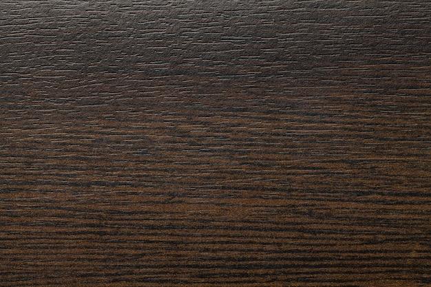 Laminato vintage shabby marrone scuro. terra d'ombra di struttura in legno