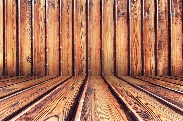 Il pannello di legno sporco scuro del grunge ha resistito al fondo della parete di legno