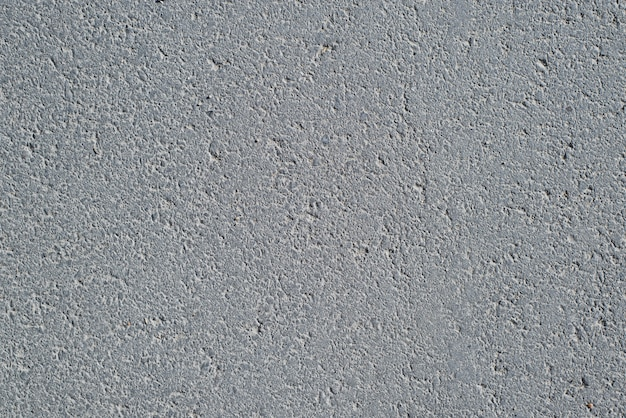 Fondo strutturato asfalto grigio scuro, vista dall'alto. sfondo di superficie stradale ruvida