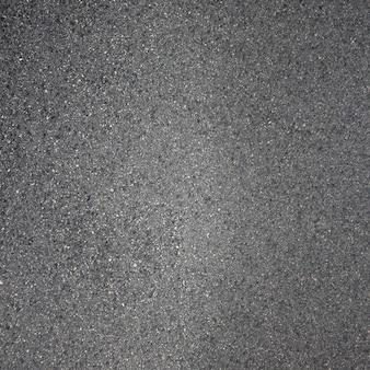 Sfondo grigio scuro con effetto asfalto