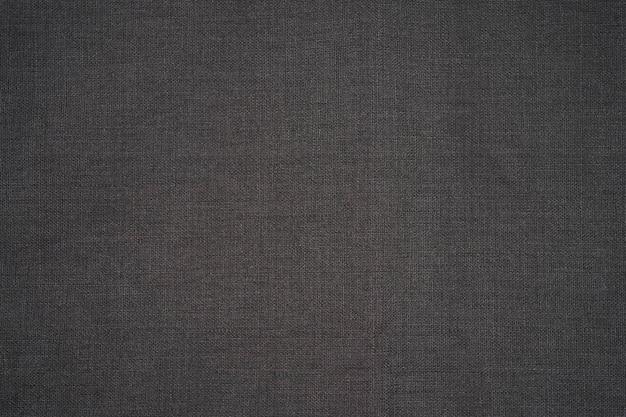 Tovagliolo di stoffa grigio scuro isolato, vista dall'alto di struttura del cotone con lo spazio della copia
