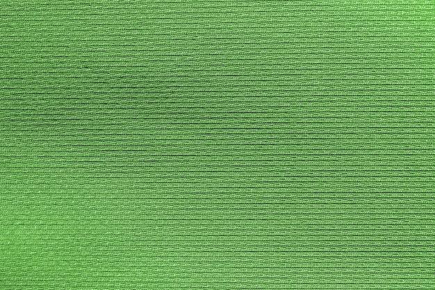 Verde scuro, marrone tessuto tessuto poliestere trama e sfondo tessile.