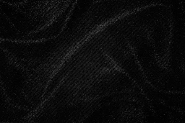 Priorità bassa di struttura del tessuto rugoso grigio scuro