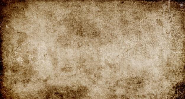 Sfondo scuro grunge, trama della vecchia carta marrone con macchie e striature