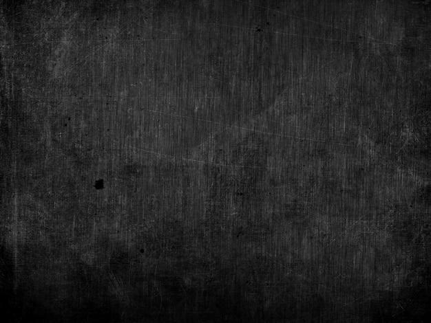 Sfondo scuro grunge con graffi e macchie