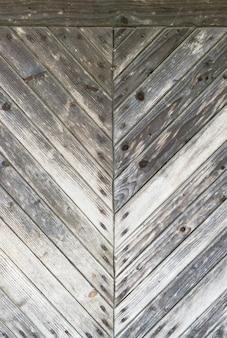 Tavola o pavimento del fondo delle plance di legno dell'annata grigio scuro e chiaro. orizzontale, vista dall'alto.