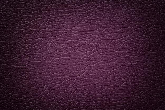 Primo piano di struttura in pelle viola scuro