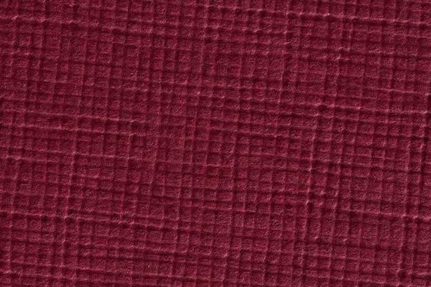 Fondo di struttura di carta controllato rosso scuro. foto ad alta risoluzione.