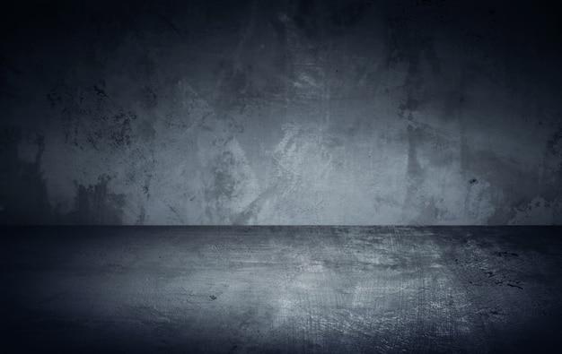 Camera buia in fascio di luce con muro di cemento e pavimento. sfondo texture.