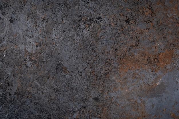 Struttura di superficie scura della vecchia pietra, parete o pavimento del grunge