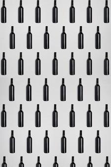 Bottiglie di vino scuro sfondo astratto scuro e strutturato creativo