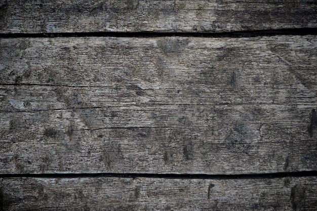 Superficie di legno scura del fondo di struttura con il vecchio modello naturale. closeup di sfondo texture legno muro nero (trasversale)