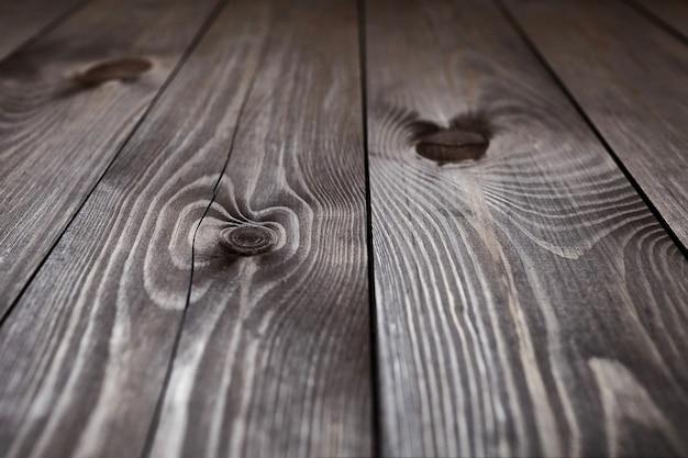 Fondo in legno scuro. tavole marroni. struttura in legno