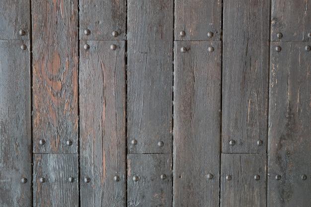Struttura di legno scura come sfondo, vista dall'alto con spazio per il testo