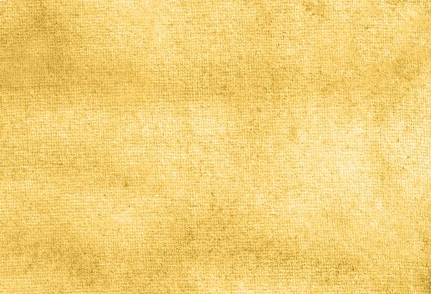 Struttura del fondo dipinta a mano dell'acquerello pastello astratto giallo scuro.